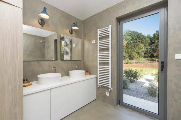The master bathroom has its own access to the gardens and to the pool